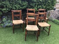 Set of 5/6. C 1920 traditional rush seated chapel chairs.