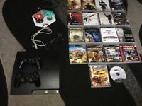 PlayStation 3 Mint condition with 2 working Controller and 18 games