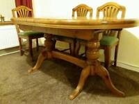Solid pine extending dining table and 6 chairs