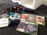 Xbox 360 slim 250GB. Comes with 6 games and Disney infinity including 8 figures