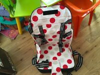 Go anywhere toddlers booster seat in a wipe clean bright material unused.