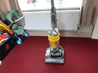 yellow dyson in good working order can see it working