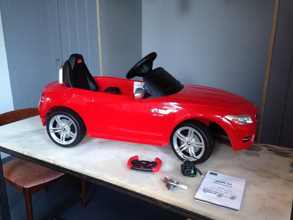 rastar bmw z4 ride on car- kids- red-never been out of the house