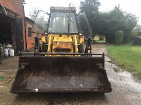 JCB 3CX backhoe loader with front and rear buckets