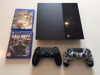 PS4 500GB Black with 2 DualShock Controllers and 2 games