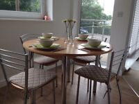 Light beech wood kitchen/ dining table and chairs