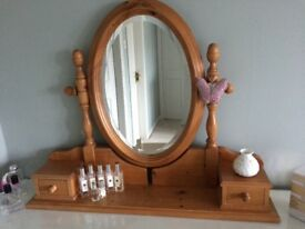 Pine oval dressing table mirror with two small drawers.