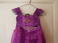 Jasmine dressing up M&S dress for ages 4 to 6 years plus slippers
