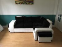 FAUX LEATHER AND FABRIC SOPRANO CORNER SOFA BED IN BLACK AND WHITE 230CM X 170CM