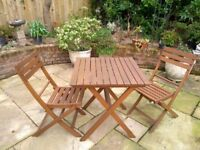 Folding table and folding chairs for the garden