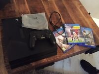 PlayStation 4 with control and 3 games