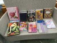 28 notebooks - various designs - lined paper - A4 and A5. Some 150 sheets some with 200 sheets
