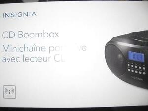 Insignia CD Player Boombox. AM / FM Radio Tuner. AUX Audio Headphones / Headset Jack. Stereo Speaker. AC Power. NEW