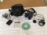 Panasonic Lumix DMC-FZ150 Digital Camera with accessories.