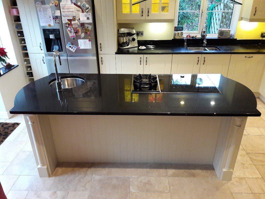 Cream Kitchen Units And Black Granite Composite Worktops