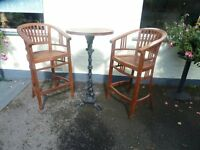 a pair of teak high bar chairs