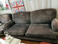 Grey velvety sofa and armchair from (sofa and stuff)