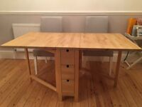 Wooden table, adjustable according to need. Good condition.