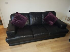 2 3seaters black leather sofas. 2yr old