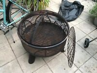 Fire Pit / BBQ with grills, lid and cover, hardly used