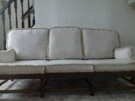 Ercol three seater sofa and pouffe