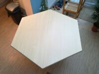 Hexagonal extending dining table