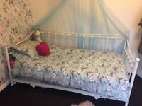 cream day bed with pull out bed
