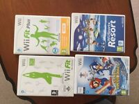 Wii complete with fitness board and several games discs.