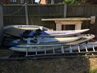 A selection of used windsurfing equipment approximately 7-8 pieces