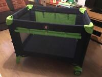 Travel cot with changing table
