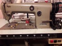 A Brother industrial sewing 240 volt including the workbench.