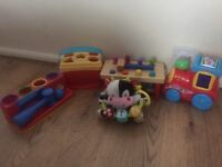 Selection of baby toys, shape sorter, fisher price musical train etc