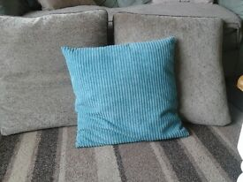 REDUCED-Three large cushions two brown,one blue