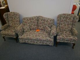 Traditional two seater drop arm sofa with matching pair of wing back chairs
