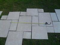 Ceramic floor tiles simulating stone slabs.