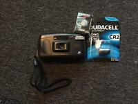 Camera with film and new batteries