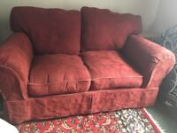 2-seater sofa, terracotta colour, loose covers, good condition.
