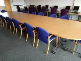 Large boardroom table and 32 chairs (can be used as folding desks)