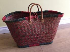 Pink and green wicker basket with leather handles