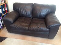 FREE. Small comfortable sofa. Brown imitation leather..