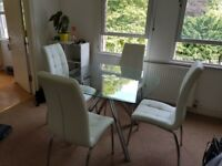 Glass table and 4 chairs for sale