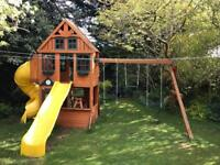 Playhouse, slides, and swings