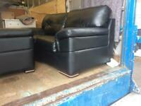 Leather two piece suite vgc sofa & chair black.