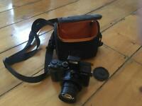 Panasonic LUMIX DMC-LX100 (Black) w carry case, charger and battery