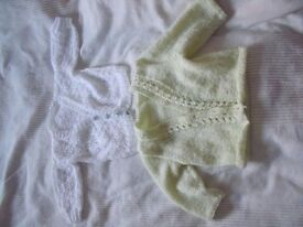 2 girls' cardigans - 0 to 3 months (white one), 3 - 6 months (green one)