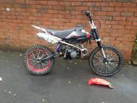 125cc pitbike, 17 front, 14 back, pro taper bars, grip and throttle