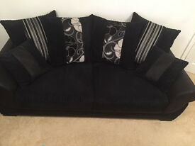 Black 3 seater sofa and 2 seater snuggle chair with foot stool.