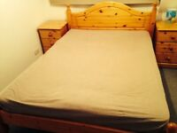 Double pinewood bed & 2 bedside tables