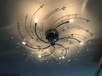 Next polished chrome flush fitting ceiling light and matching lamp