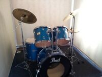Retired drum teacher has 3 Pearl Export drum kits for sale individually.